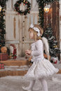 Christmas angel girl in white clothes Stock Image