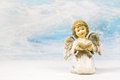 Christmas angel reading in a book telling a story for xmas on background greeting card Stock Photo