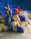 Christmas Ornaments. Three blue gift boxes. Royalty Free Stock Photo