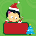 Christmas Asian baby girl holding sign Royalty Free Stock Photography