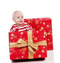 Christmas baby boy with gift box, baby is sitting Stock Photo