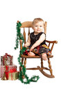 Christmas baby with gifts rocks in patchwork dress Royalty Free Stock Image