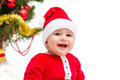 Christmas baby happy smiling wearing a red and white santa hat and suit isolated on a white background Royalty Free Stock Images