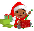 Christmas baby open gift cute Stock Photo