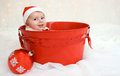 Christmas baby in red bucket Royalty Free Stock Image
