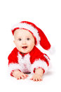 Christmas baby in santa claus clothes over white background Royalty Free Stock Photography