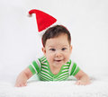 Christmas baby in santa hat on white background Stock Images