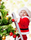 Christmas baby on a step ladder Stock Image