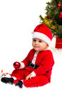 Christmas baby wearing a red and white santa hat and suit isolated on a white background Royalty Free Stock Image