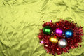 Christmas background ball on the green satin concept Royalty Free Stock Images