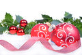 Christmas background with balls and holly leaves and berries isolated on the white Stock Photos
