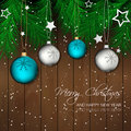 Christmas background with bauble, pine needles and wooden texture for greeting card and happy holiday