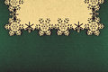 Christmas background with beige snowflakes and copy space on xmas green background Royalty Free Stock Photo