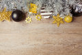 Christmas background with black, golden and silver decorations on wooden table. View from above with copy space Royalty Free Stock Photo