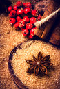 Christmas background with brown sugar anise star and cinnamon s sticks on wooden table macro still life food Stock Image