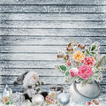 Christmas background with a bunch of flowers with frost, snowman, Christmas ornaments on a snowy wooden board Royalty Free Stock Photo