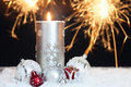 Christmas background with candle and sparklers Stock Photo