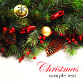 Christmas background. Christmas boarder with fir tree branch with cones and ornament. Christmas baubles in golden and red colour. Royalty Free Stock Photo