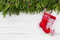 Christmas background. Christmas fir tree, red Christmas socks on white wooden background. Copy space Royalty Free Stock Photo