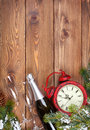 Christmas background with clock, snow fir tree and champagne Royalty Free Stock Photo