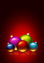 Christmas background with colorful glass balls over dark red Stock Images