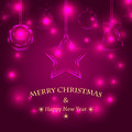 Christmas background with decorations tree decorations on purple glittering neon effect Stock Photography