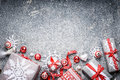 Christmas background festive gift boxes and presents paper snowflakes red ribbons and decoration top view Royalty Free Stock Photo