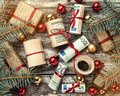 Christmas background, fir branches, gifts, baubles, money of different values. Top view Royalty Free Stock Photo