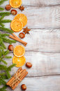 Christmas background with Fir Branches, Nuts, Spices and Dried oranges. Royalty Free Stock Photo