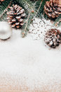 Christmas background with fir and pinecones