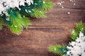 Christmas background fir tree border on a wooden surface Stock Photos