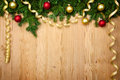 Christmas background with firtree baubles and ribbons on wood fresh horizontal Stock Image