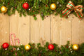 Christmas background with firtree, candies and baubles Royalty Free Stock Photo
