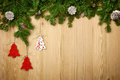 Christmas background with firtree, decorative trees and cones on Royalty Free Stock Photo