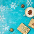 Christmas background with gift boxes, coffee cup