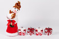 Christmas background with gift boxes over white board Royalty Free Stock Photo