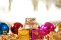 Christmas background with gifts and baubles Stock Photos