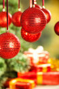 Christmas background - gifts, tree and baubles Royalty Free Stock Photography