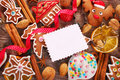 Christmas background with gingerbread cookies cutters and spice greeting card homemade spices nuts on wooden board Stock Image