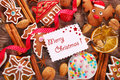 Christmas background with gingerbread cookies cutters and spice greeting card homemade spices nuts on wooden board Royalty Free Stock Images