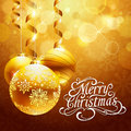 Christmas background with gold balls and merry christmas calligraphic typography Royalty Free Stock Photography