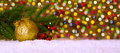 Christmas red ball or candle with golden ornaments,silver ribbon and snow.