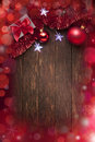 Christmas background lights a with presents red tinsel ornaments and star on a warm rustic wood Royalty Free Stock Photography