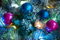 Christmas background with lights, tinsel, and Christmas balls Royalty Free Stock Photo