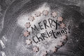 Christmas background. Merry Christmas written with flour and biscuits stars Royalty Free Stock Photo