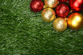 Christmas background ornament on the green grass concept Royalty Free Stock Images