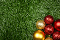 Christmas background ornament on the green grass concept Stock Image