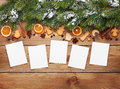 Christmas background with photo frames, snow fir tree, spices an Royalty Free Stock Photo