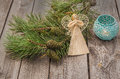 Christmas background with pine branches and straw angel Royalty Free Stock Photo