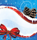 Christmas background with pine cones and a red bow Royalty Free Stock Images